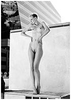 Dorith Mous - Nude editorial on roof by Mario Kroes